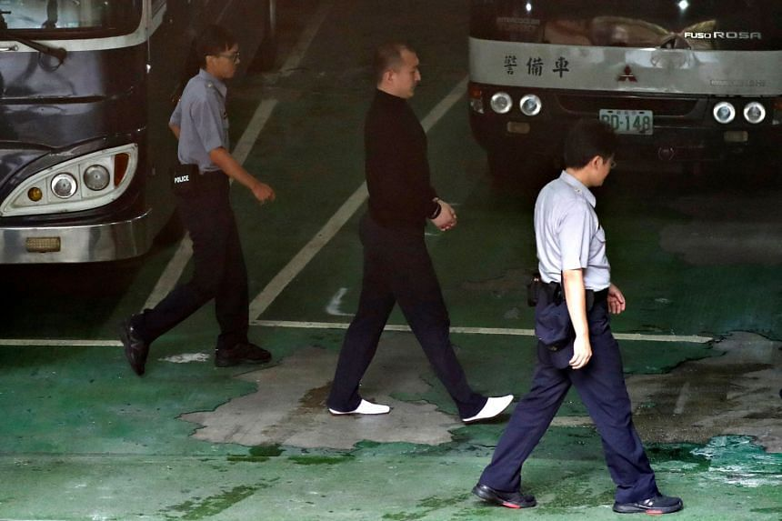 Mainland Chinese student Zhou Hongxu (centre) leaves handcuffed from court after being sentenced for imprisonment for breaching national security laws at district court, in Taipei, Taiwan on Sept 15, 2017.