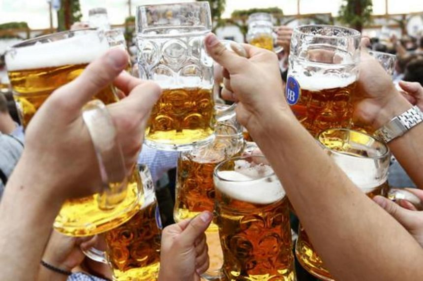 Visitors toast with beer on the first day of the 182nd Oktoberfest in Munich, Germany, on Sept 19, 2015.