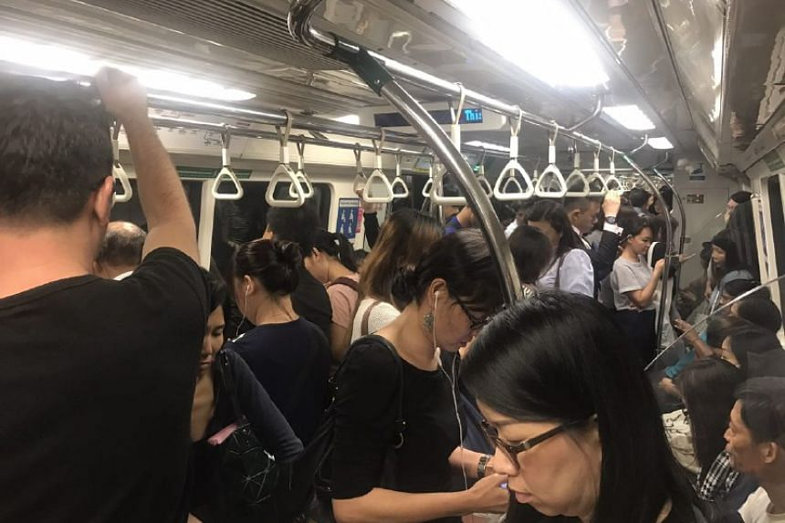 Commuters in a train that had stalled at Orchard MRT Station on Friday (Sept 15) night.