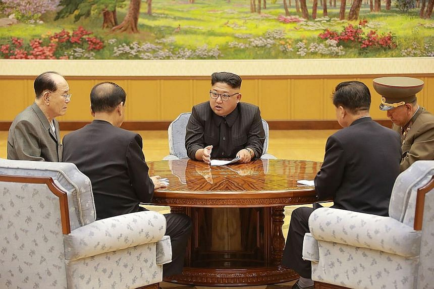 North Korean leader Kim Jong Un at a meeting with a committee of the Workers' Party of Korea on Sept 4, a day after Pyongyang detonated a hydrogen bomb designed for a long-range missile, in what was its sixth and most powerful nuclear test, sparking