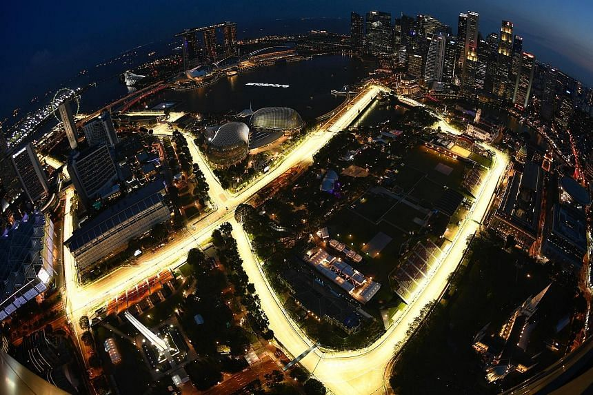 The Marina Bay Street Circuit, seen from Swissotel The Stamford last night, brightly lit up amid final preparations for today's first two practice sessions as the 10th Singapore race weekend gets under way.