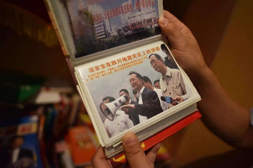 Confiscated promotional material for an illegal pyramid scheme, featuring an image of former Chinese Premier Wen Jiabao, at an office in Beijing.