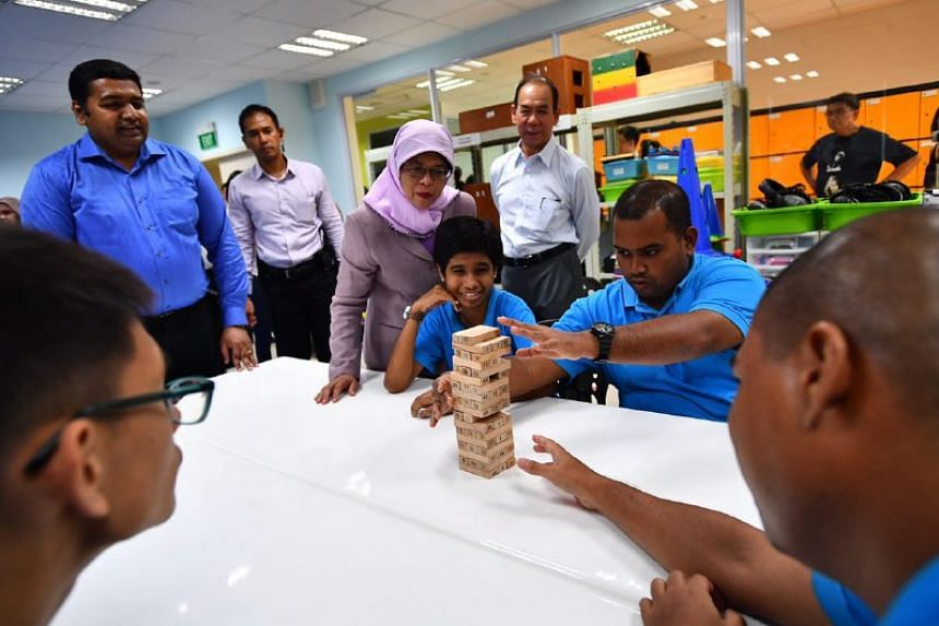 President Halimah Yacob interacting with trainees undergoing the social skills programme.