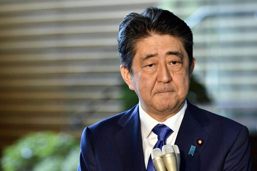 Japanese Prime Minister Shinzo Abe reacts as he speaks to journalists upon his arrival at the prime minister's official residence in Tokyo, Japan, on Sept 15, 2017.