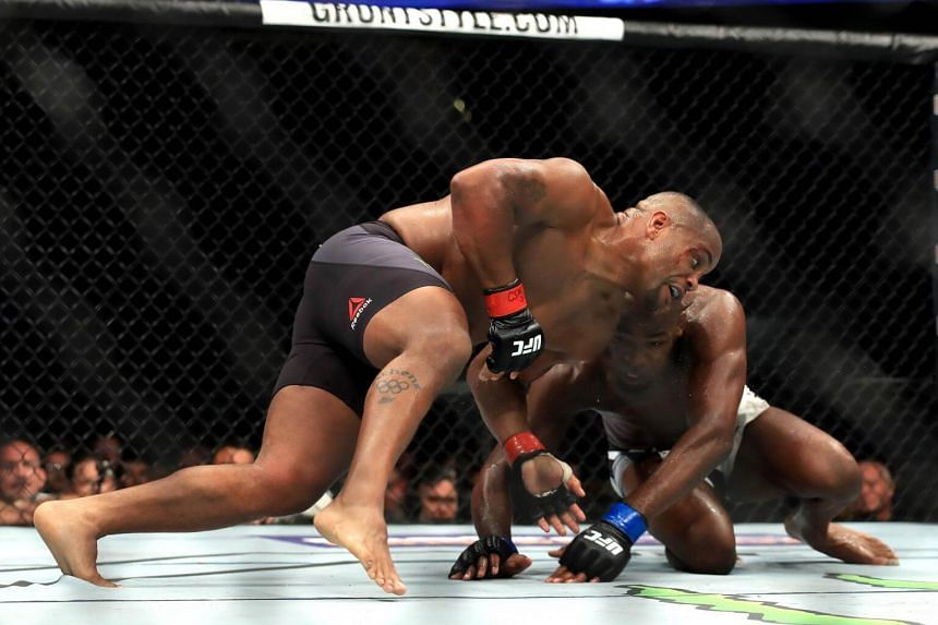 Daniel Cormier (left) fights Jon Jones in the Light Heavyweight title bout during UFC 214 at Honda Center on July 29, 2017 in Anaheim, California.