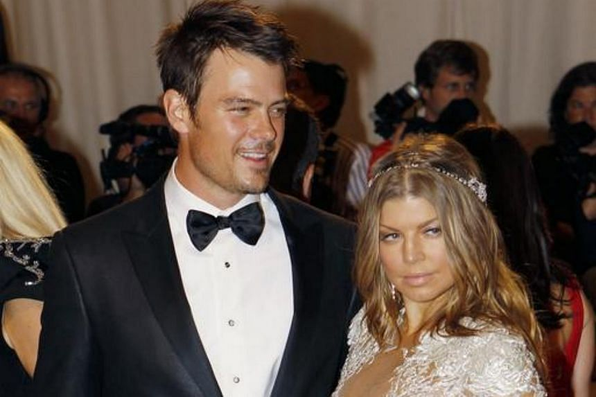 Actor Josh Duhamel and singer Fergie arrive at the Metropolitan Museum of Art Costume Institute Benefit in New York, in this May 2, 2011, file photo.