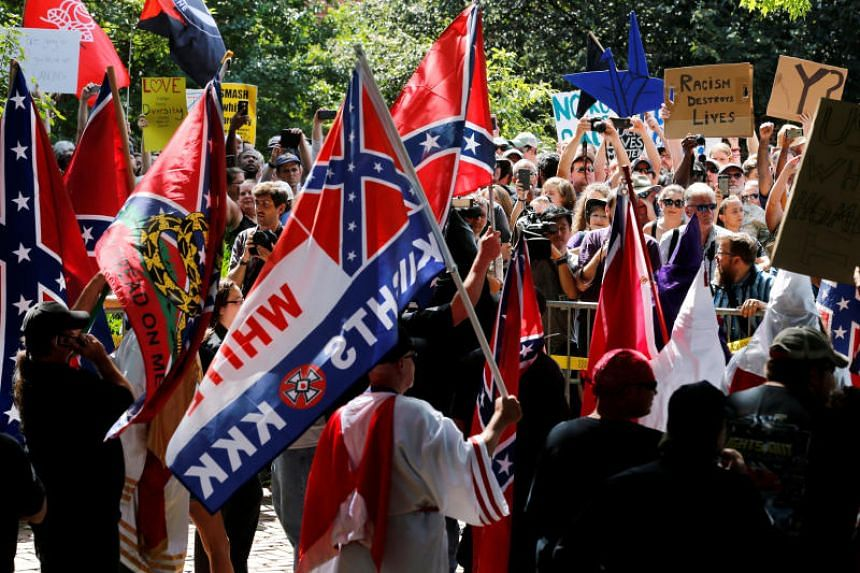 Members of the Ku Klux Klan face counter-protesters as they rally in support of Confederate monuments in Charlottesville, Virginia, U.S. on July 8, 2017.