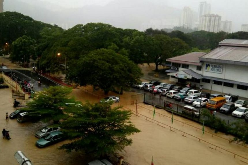 The Permata Sports Complex in Paya Terubong inundated by floodwaters.