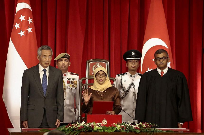 President-elect Halimah Yacob  takes the oath of office at the Istana Presidential Palace on Sept 14, 2017.