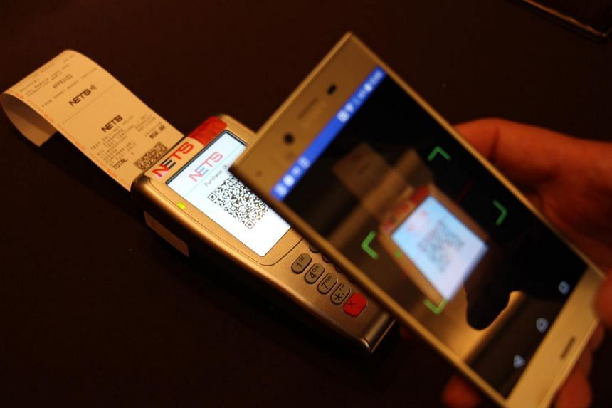 Nets payment using a mobile phone.