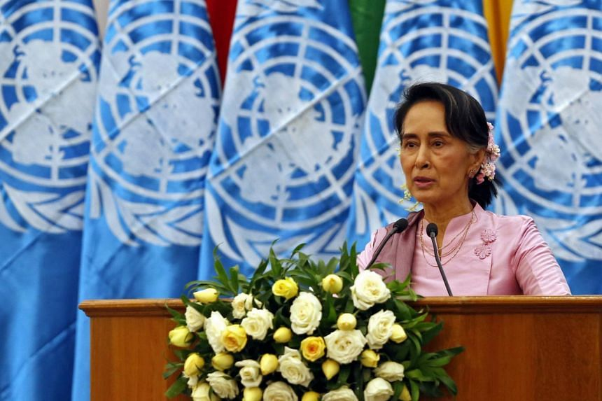 Myanmar's State Counselor Aung San Suu Kyi speaks during a ceremony on International Women's Day at MICC-2 in Naypyitaw, on March 8, 2017.