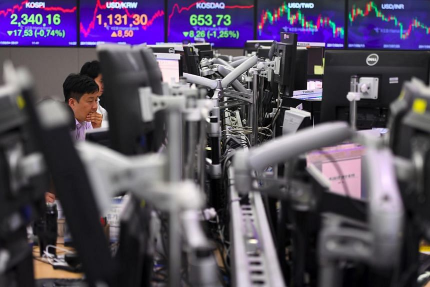 A currency dealer monitors exchange rates in a trading room at the KEB Hana Bank in Seoul on Sept 4, 2017.