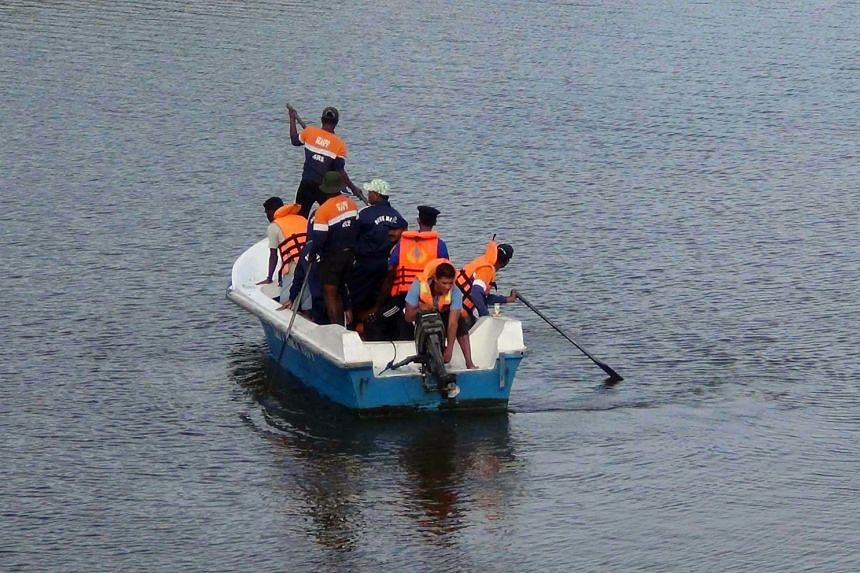 Sri Lankan rescue officials search for the body of British journalist Paul McClean in a lagoon near the coastal village of Panama, 360 kilometres east of the capital Colombo, on Sept 15, 2017.