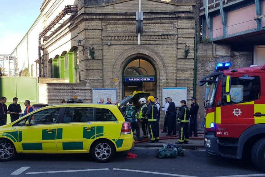 Emergency services attend the scene following a blast on an underground train at Parsons Green tube station in West London on Friday (Sept 15).