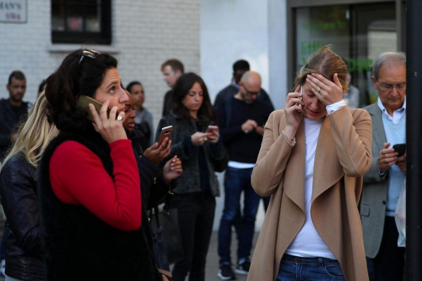 People react near Parsons Green tube station in London following reports of explosion in the station on Friday (Sept 15).