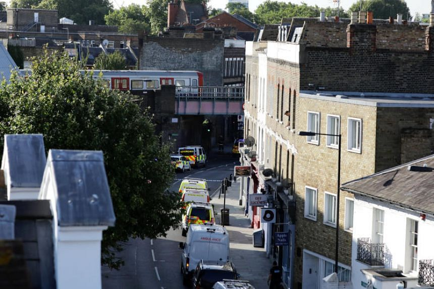 Police vehicles line the street near Parsons Green tube station following reports of an explosion on Friday (Sept 15).