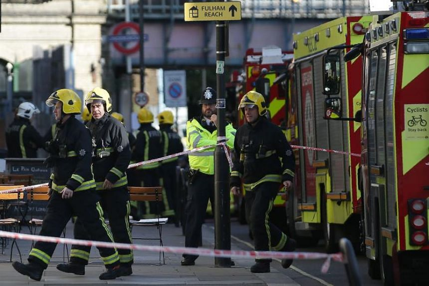 Members of the emergency services work outside Parsons Green underground tube station in west London on Friday (Sept 15), following an incident on an underground tube carriage at the station.