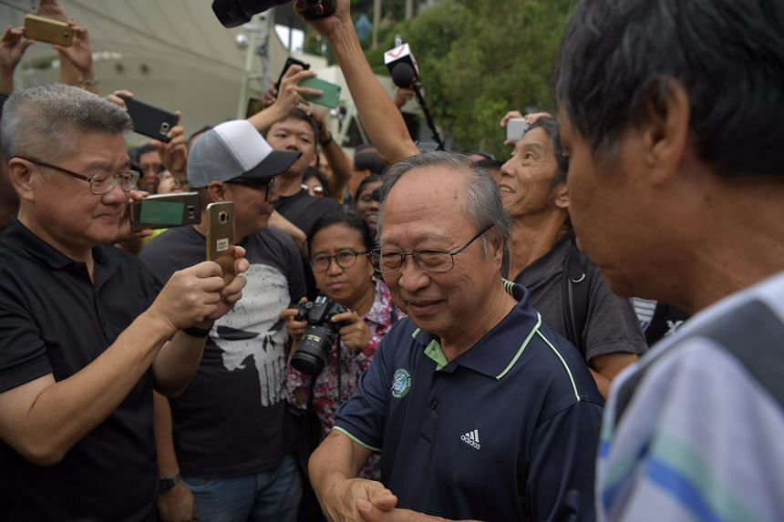Dr Tan Cheng Bock shake hands with supporters and well-wishers at the protest.