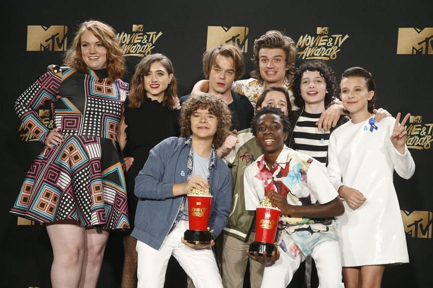 The cast of Netflix's Stranger Things with their MTV Show of the Year Award.