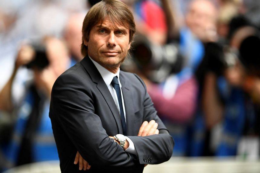 Conte (above) reckons Arsenal have the squad to fight for the Premier League title.