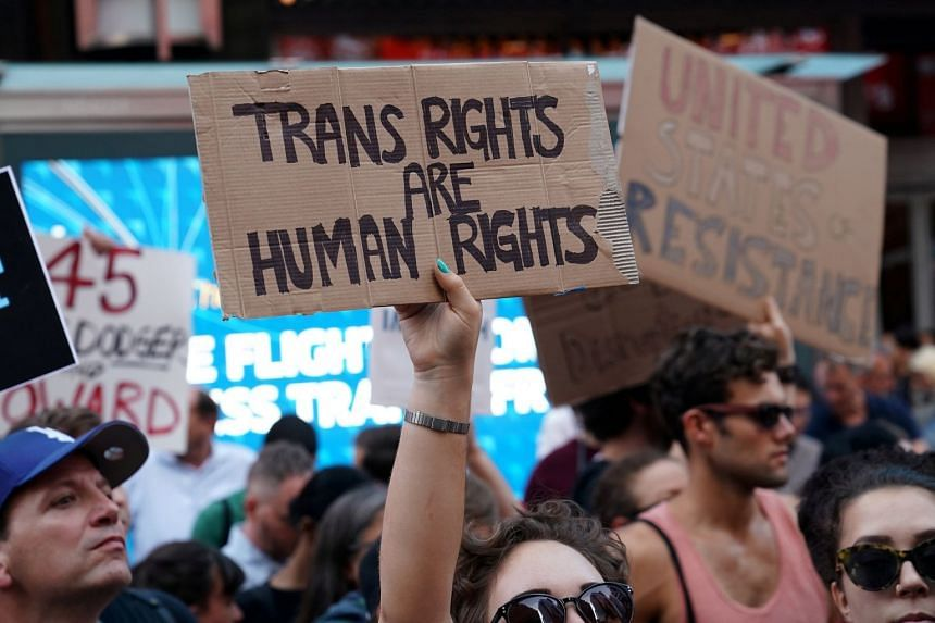 People protesting against Donald Trump's planned ban on transgender individuals serving in the military in July 2017.