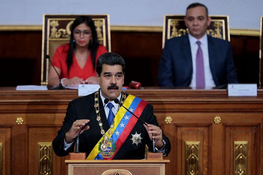 Venezuelan President Nicolas Maduro (centre) addresses the National Constituent Assembly in Caracas, Sept 7, 2017.