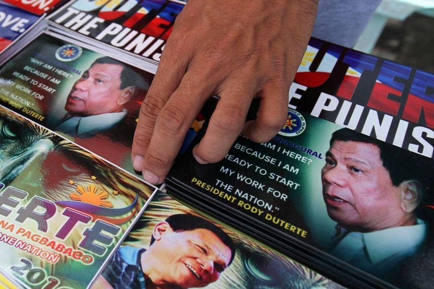A vendor selling souvenir items with images of Philippine President Rodrigo Duterte.