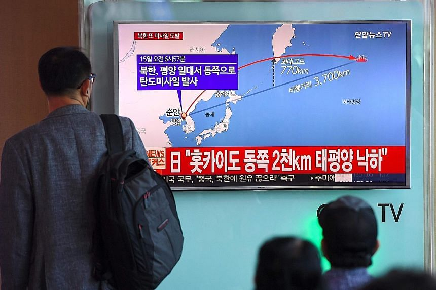 The North Korean missile launch being shown on TV in Seoul yesterday.