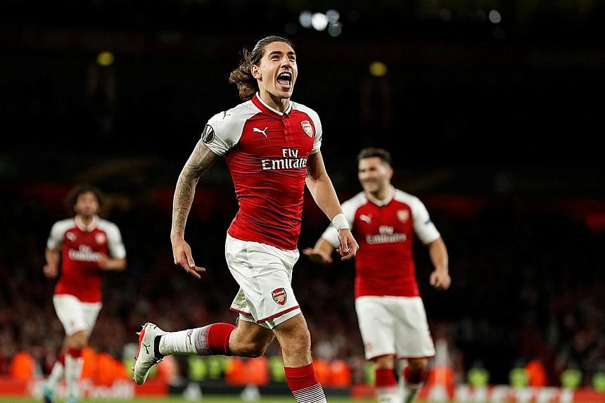 Arsenal's Hector Bellerin celebrating after he scored their third goal against FC Cologne.