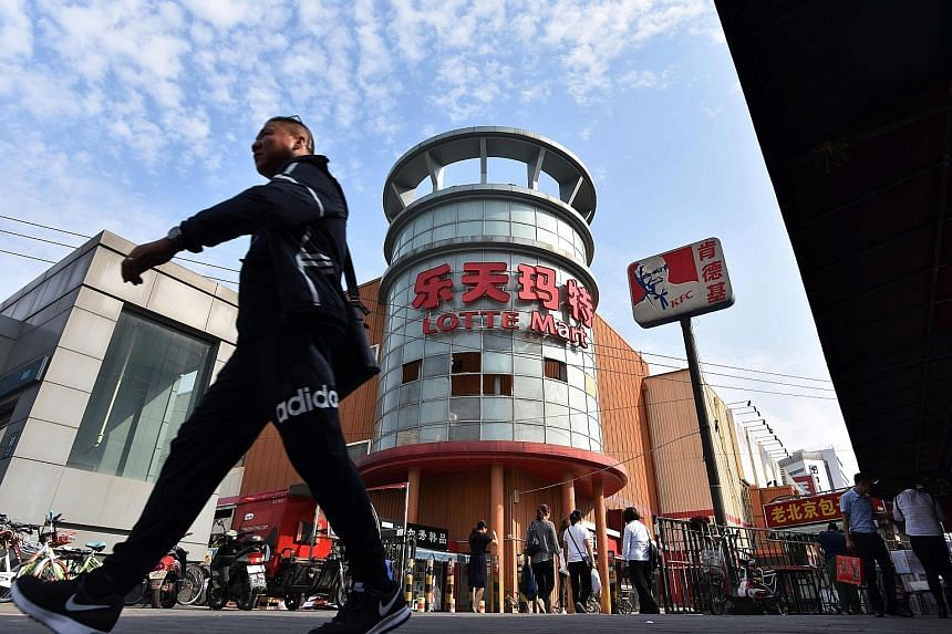 A shuttered Lotte Mart store in Beijing yesterday. The South Korean conglomerate, which was forced to close most of its 112 discount stores in China, has since expanded investments in Vietnam and Indonesia.
