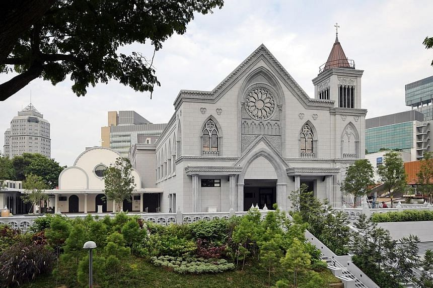 The new prayer hall, which includes the sanctuary (right), towers over the original 1950s building (left), which has been conserved. The church will hold its first mass on Sept 29 after being closed for nearly three years.