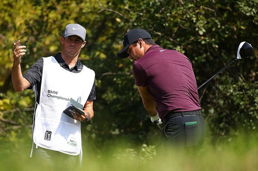 Caddie Luke Reardon giving Jason Day pointers at the seventh tee in the first round of the BMW Championship. Day's childhood friend is standing in after the Australian golfer parted ways with Col Swatton, who will stay on as instructor.