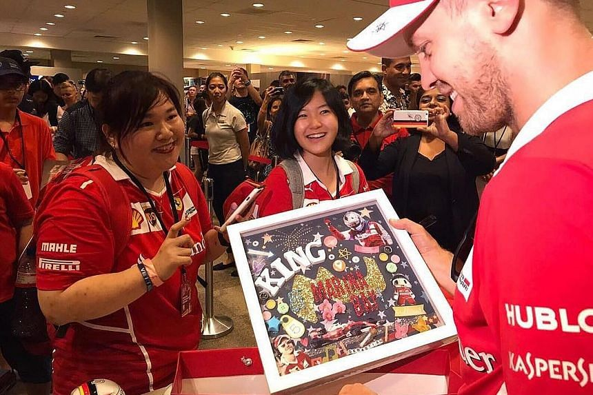 Never underestimate the power of visualisation in sports. This fan probably clocked the lap record around the Marina Bay street circuit. Ferrari's Sebastian Vettel receiving a fitting gift from a supporter. No driver has won the Singapore Grand Prix