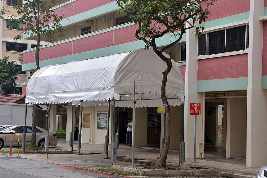 The white awning covers a carpark space reserved for police vehicles.