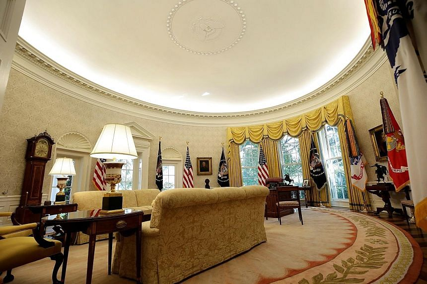 After a $4.6-million overhaul, the Oval Office's yellow candy-stripe wallpaper has been replaced with a creamy grey damask version, among other changes.