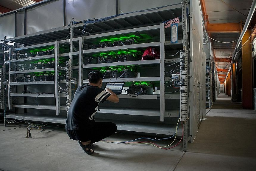 An employee at Bitmain, one of the largest Bitcoin farms in the world, in Inner Mongolia. Beijing's motivation for the exchange ban comes amid a broad clampdown on financial risk in the run-up to a Communist Party leadership reshuffle next month.