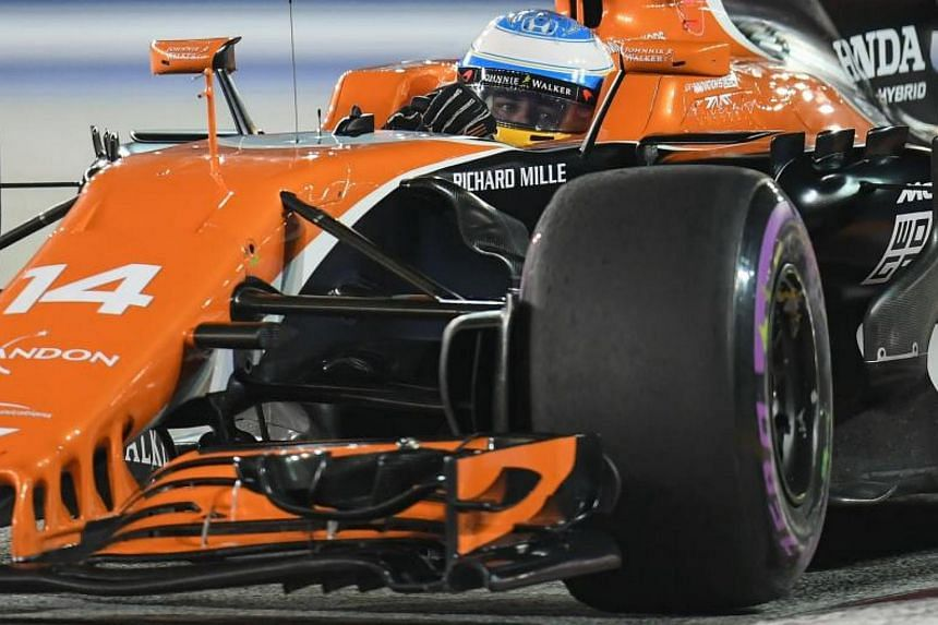 McLaren's Spanish driver Fernando Alonso takes a corner during the second practice session of the Formula One Singapore Grand Prix in Singapore on Sept 15, 2017.