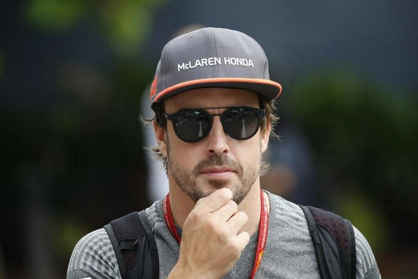 Spanish Formula One driver Fernando Alonso of McLaren Honda F1 Team arrives at the paddock before the third practice session at the Singapore Formula One Grand Prix night race at Marina Bay Street Circuit, Singaporen on Sept 16, 2017.