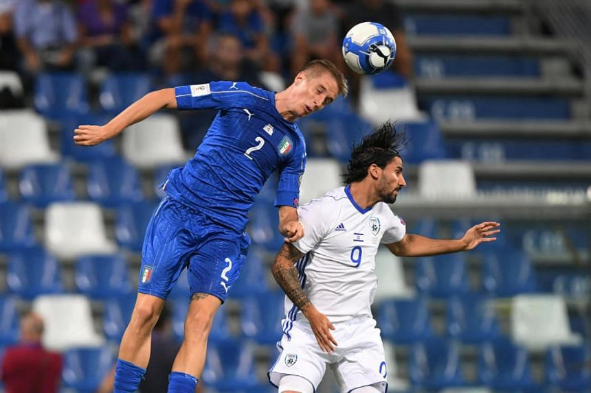 Italy's Andrea Conti in action with Israel's Lior Refaelov during the hosts' 1-0 win in their 2018 World Cup qualifying game in Reggio Emilia on Sept 5, 2017.