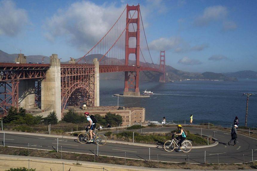 Cyclists ride along the bike paths around the Golden Gate Bridge in San Francisco, California,