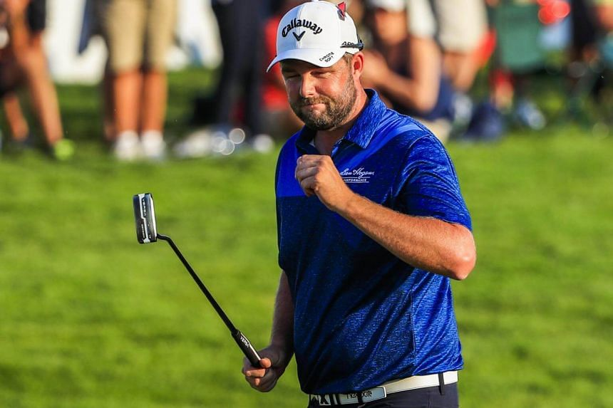Marc Leishman walks across the eighteenth green after putting in during the second round of the BMW Championship, on Sept 15, 2017.