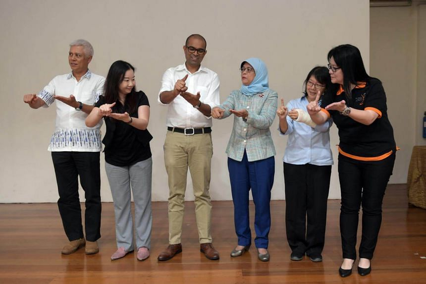 President Halimah Yacob and Senior Minister of State for Education Janil Puthucheary,  with SADeaf representatives and award winners.