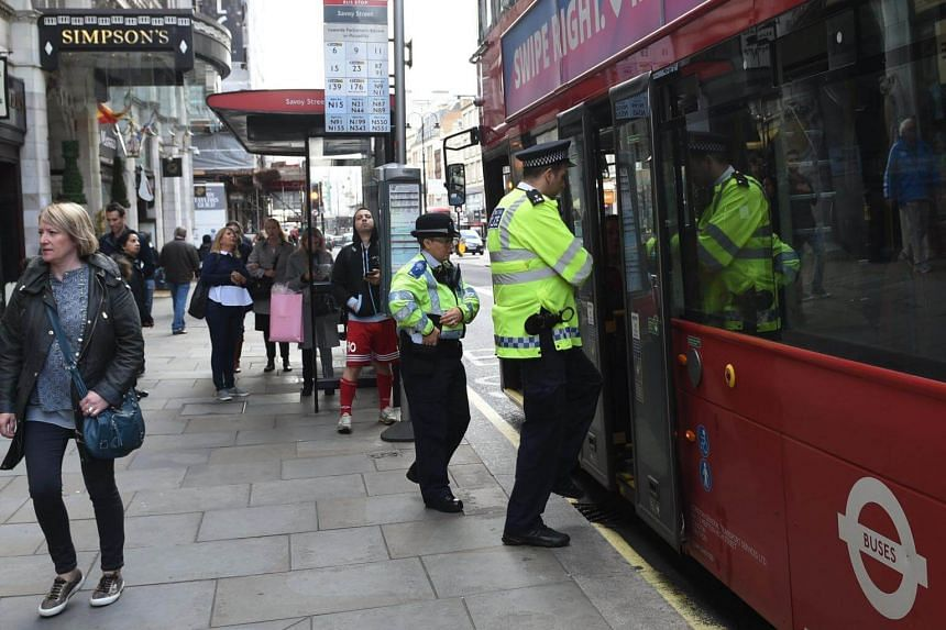 Police patrol a London bus after the terror level was increased to 'critical' after the terrorist attack in Parsons Green station, London in Britain, on Sept 16, 2017.
