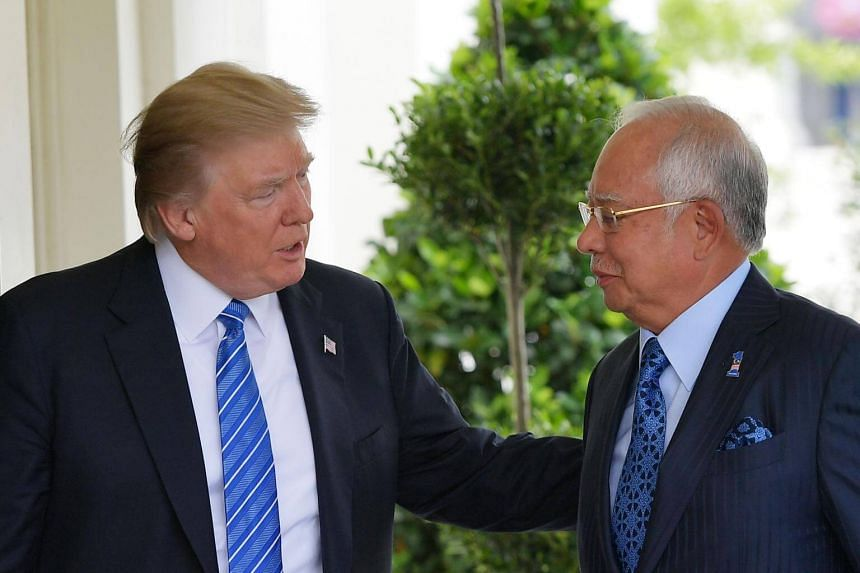 US President Donald Trump greets Malaysian Prime Minister Najib Razak outside of the West Wing of the White House on Sept 12, 2017, in Washington, DC.