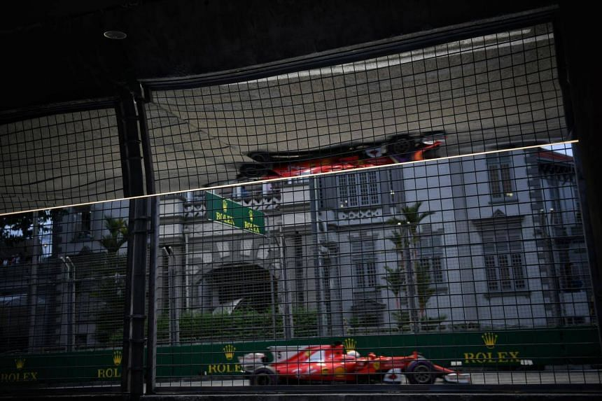 Ferrari's Sebastian Vettel after turn 10 at the 2017 Formula One Singapore Airlines Singapore Grand Prix at the Marina Bay street circuit on Sept 16, 2017.