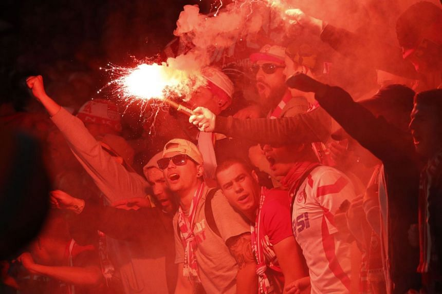 Cologne fans light flares inside the stadium during the Europa League match.