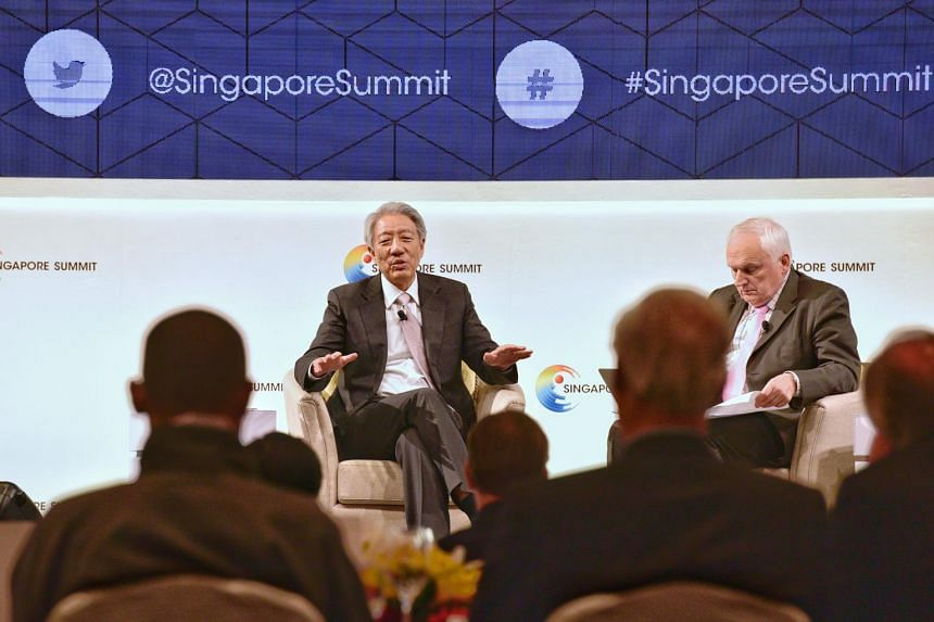 DPM Teo (left) speaking at the opening of the Singapore Summit, a two-day forum attended by 500 foreign leaders, businessmen and others.