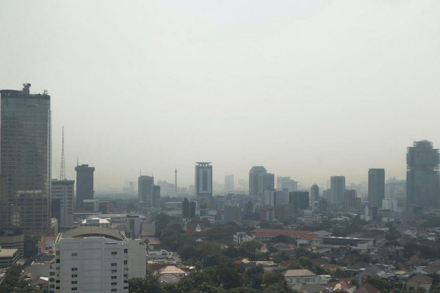 Haze shrouds the Indonesian capital Jakarta on July 27, 2017.