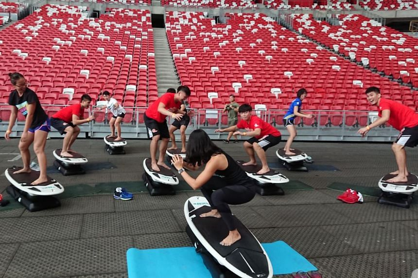 Testing the obstacles at the the Great Eastern Warriors Challenge at the National Stadium.