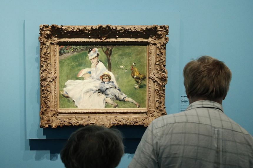 A painting entitled Madame Monet Et Son Fils Jean Dans Le Jardin A Argenteuil (Camille Monet And Her Son Jean In The Garden At Argenteuil), by French artist Pierre Auguste Renoir, on show at the exhibition, Monet Collector: Masterpieces From His Coll